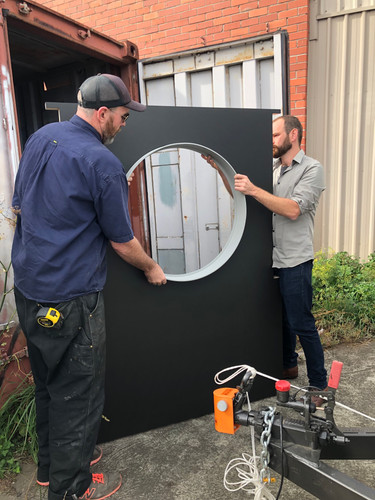 Arhictect, Dan Devine, and builder, Guy Paramore, test out the window framing.