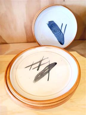 terracotta and white glaze plates