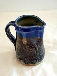 wood fired blue milk jug