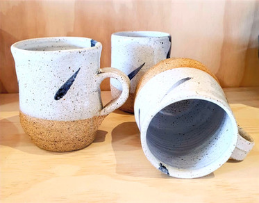 spekled white cups
