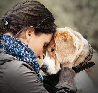 bigstock-Woman-With-Her-Dog-Tender-Scen-89621747.jpg