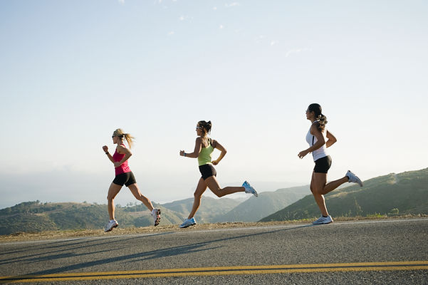 High performance eating athletes running in the mountains
