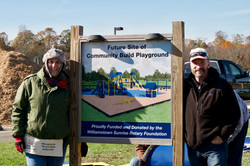 Don Kensey next to Rotary sign