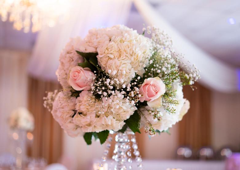 Hydrangea and Pink Rose Flower Arrangement on a Crystal Candelabra