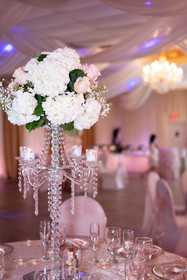 Blush Rose and Hydrangea Flower Arrangement on a Crystal Candelabra at BelaRosa by the Airport