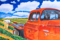 Orange GMC Farmer