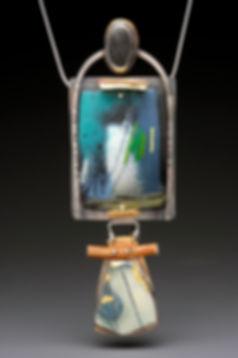 "Enamel pendant with sterling, brass, pottery shard, wood, beach stone.  2"" x  4"""