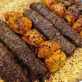 Freshly Cooked Ground Beef Shami Kabob and Chicken Kabob side by side in a catering tray from Sacramento Kabob Palace.