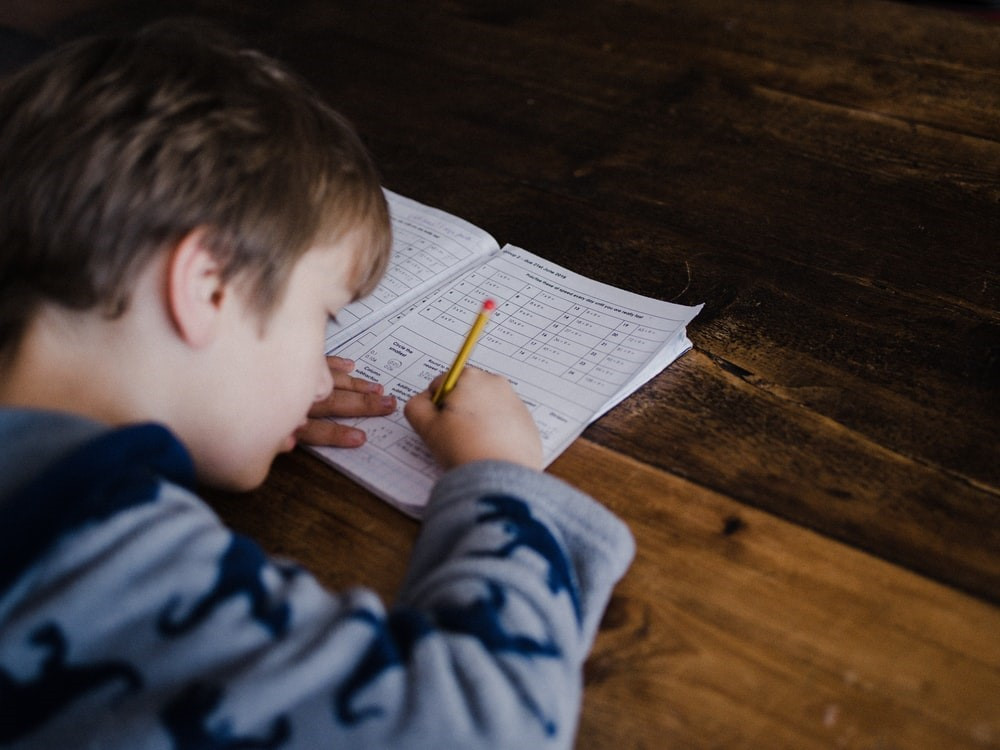 A kid practicing math