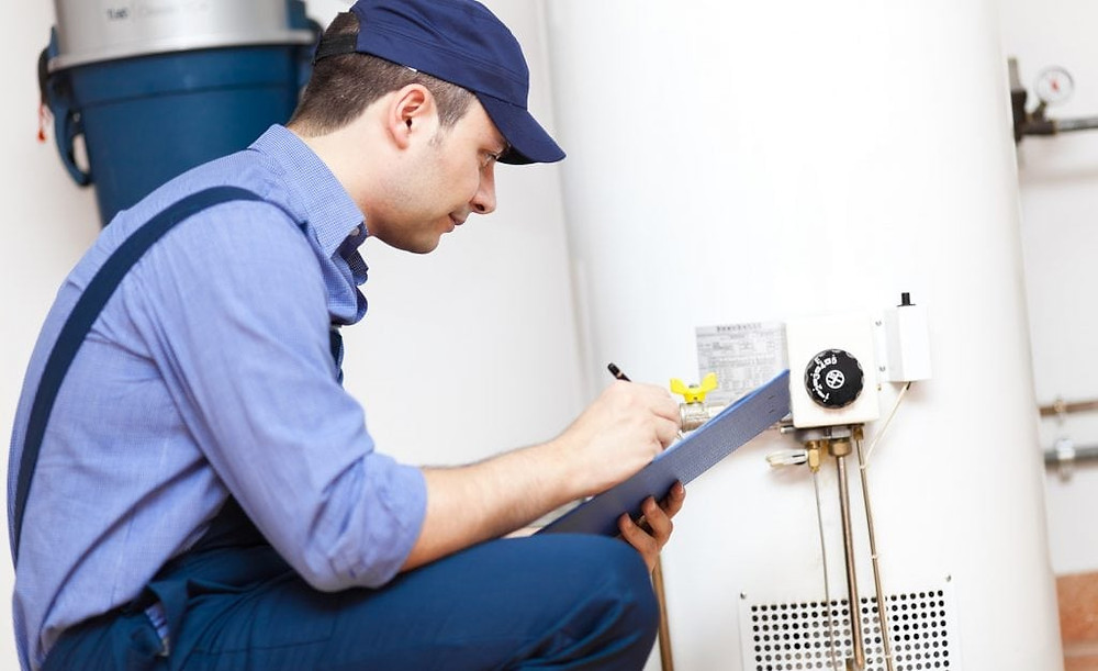plumber inspects hot water system