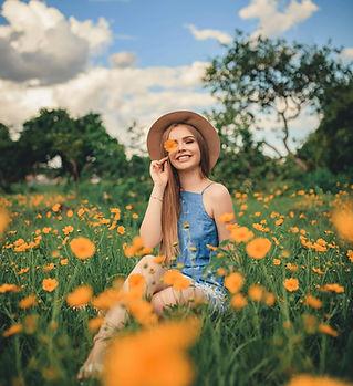 woman-sitting-on-flower-field-3216176.jp