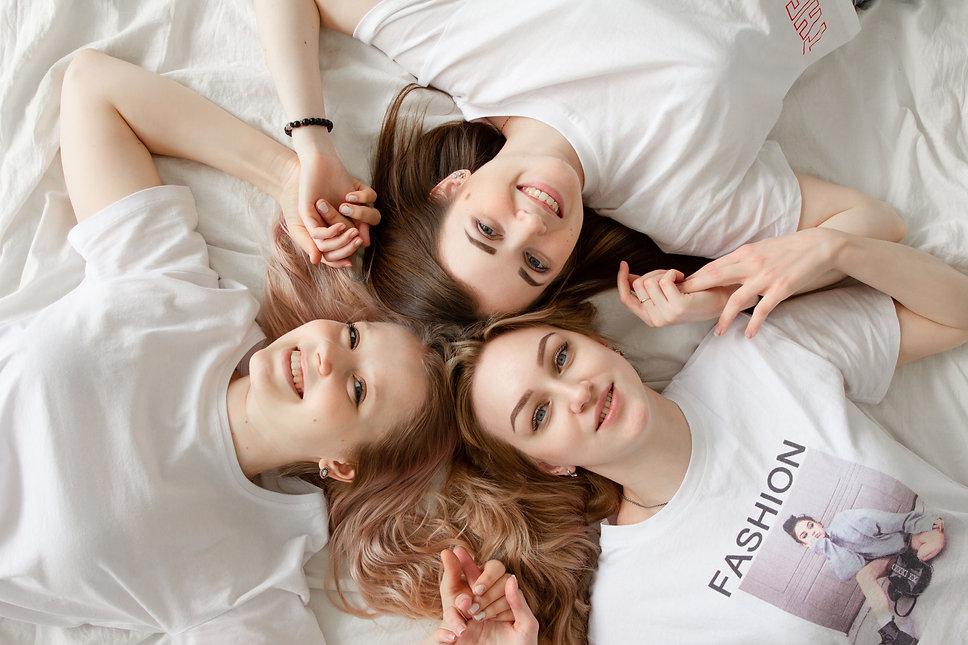 Canva - Three Women Lying On Bed.jpg