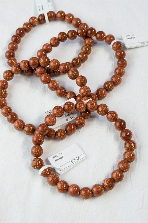 Goldstone Elastic Bracelet: Ambition. Confidence, Protection