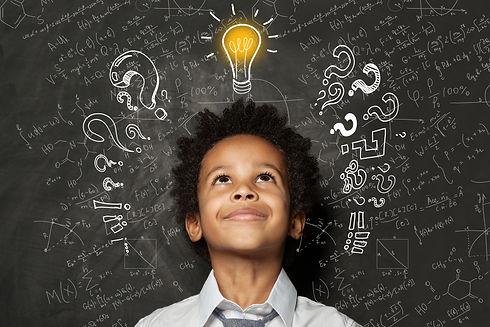 Smart black kid with lightbulb. Brainsto