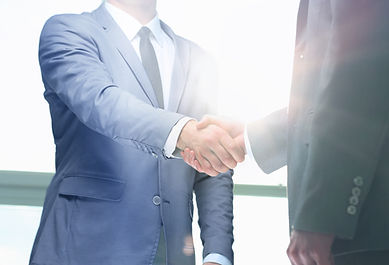 Business people shaking hands closed title
