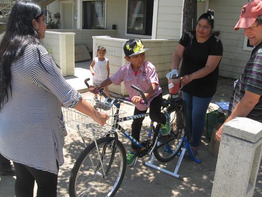 Boy on bike blender Festival