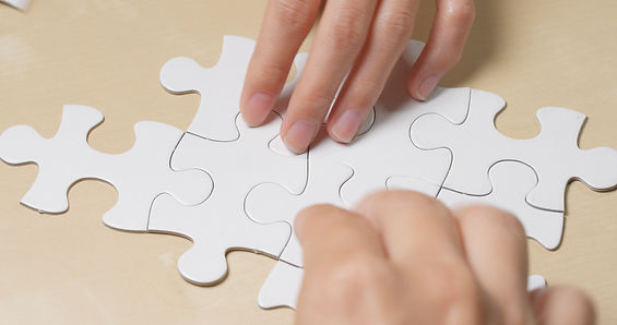 teamwork-concept-completing-white-puzzle