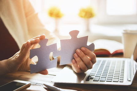 woman-connects-couple-puzzle-piece-P9A5F
