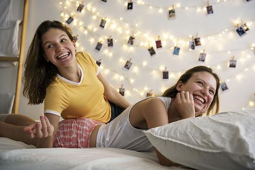 women-lying-bed-together-min.jpg