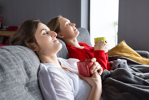 female-roommates-having-cold-resting-hom