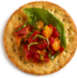 Milton's Gourmet Garlic & Herb Crackers paired with roasted, heirloom bruchetta and fresh basil