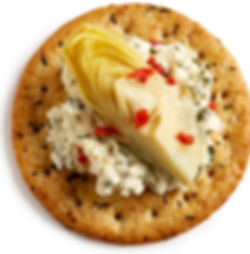 Milton's Gourmet Everything Crackers with herb cheese and topped with marinated artichoke heart