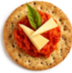Milton's Gourmet Multi-Grain Crackers with roasted red pepper & egg plant puree with sliced white cheddar cheese