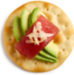 Milton's Gourmet Crispy Sea Salt Crackers topped with fresh ahi, sliced avocado and pickled ginger