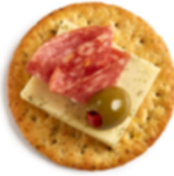 Milton's Gourmet Garlic & Herb Crackers topped with Havarti cheese, salami and green olive