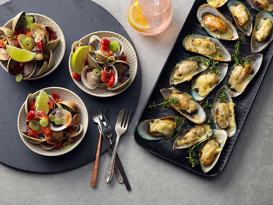 Greenshell Mussels Grilled and Littleneck Clams with Garnish served as entree options