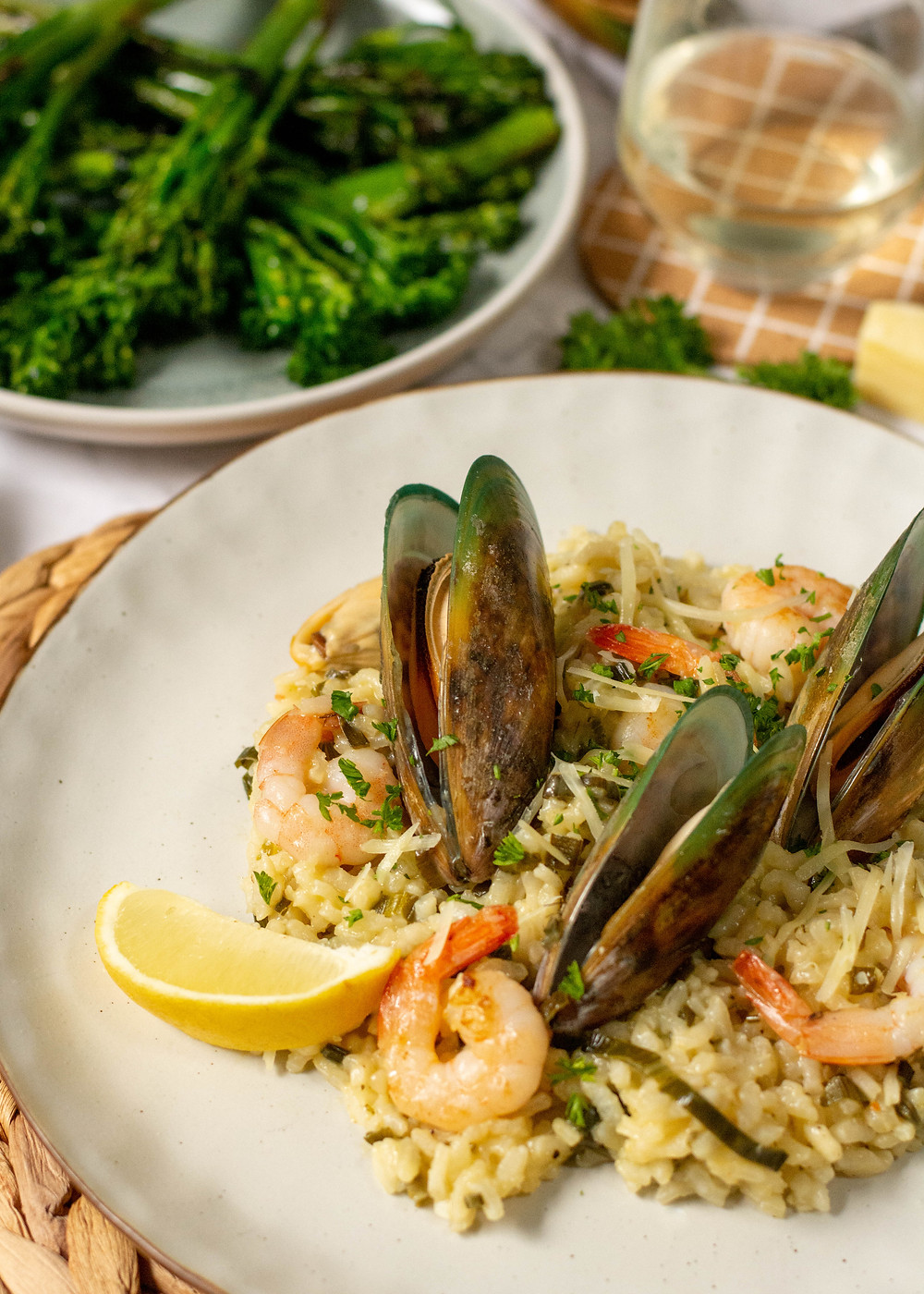 rmussel and prawn risotto with broccoli on a table scape