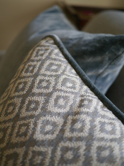 Cushion with contrast piping