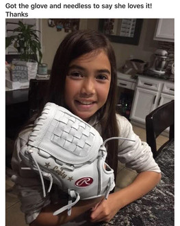 This Lefty just got her softball glove back in the mail! That smile says it all!