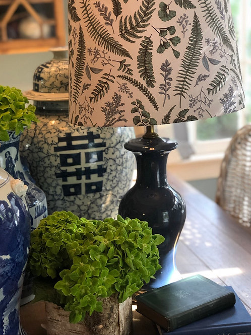 Blue lamp with floral shade