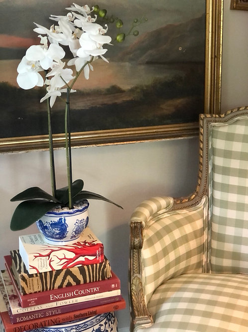 Faux orchid in blue and white pot
