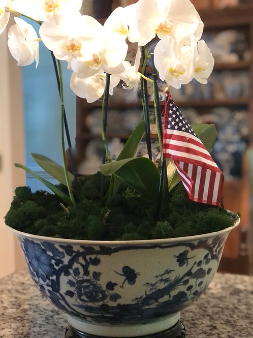 Large blue and white bowl with floral scene