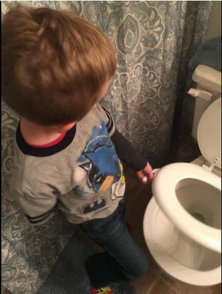 Son using the Sani-Hani