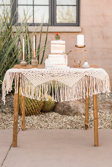 a small accent table set up for a wedding cake
