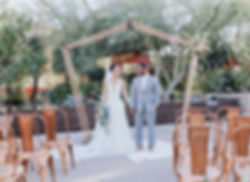 a copper wedding arbor at a outdoor wedding.
