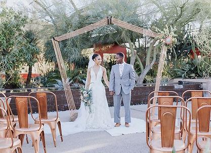 a copper wedding arbor at a outdoor wedding.