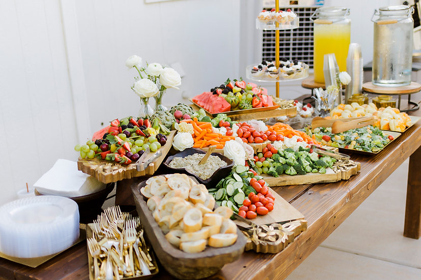 a buffet table set for a grazing table for a wedding