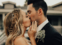 Bride and groom in a romantic kiss at a arizona wedding.  Showing off braid in brides hair and boutonniere on groom.