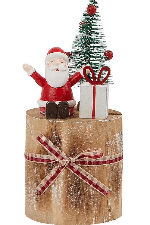 Santa Sitting on a Wooden Post