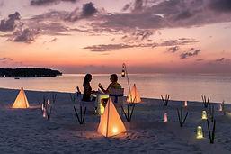 MALDIVES BEACH DINING iStock-1028749064.