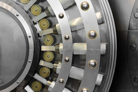 An open safe door in a vault.jpg
