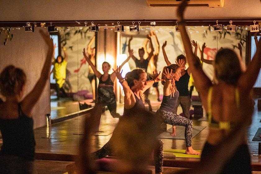 Women doing yoga in a yoga studio