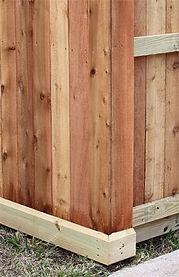 Fence with beveled bottom rail