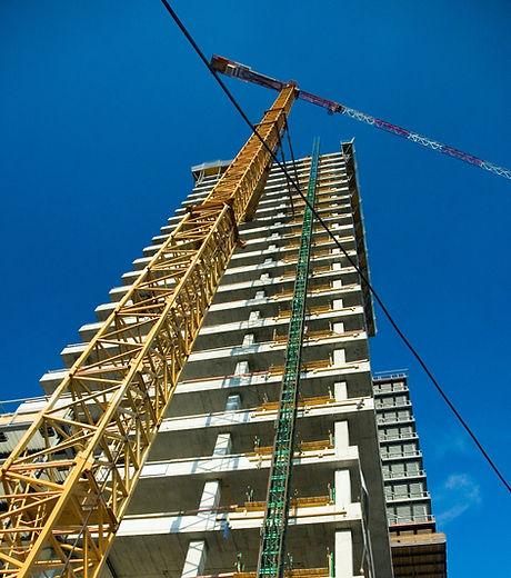 industrial-crane-near-constructed-buildi
