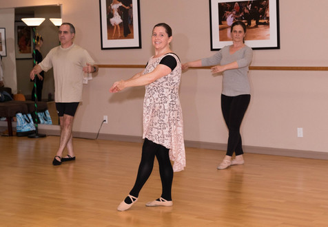 Ballet trio dancing in a group class