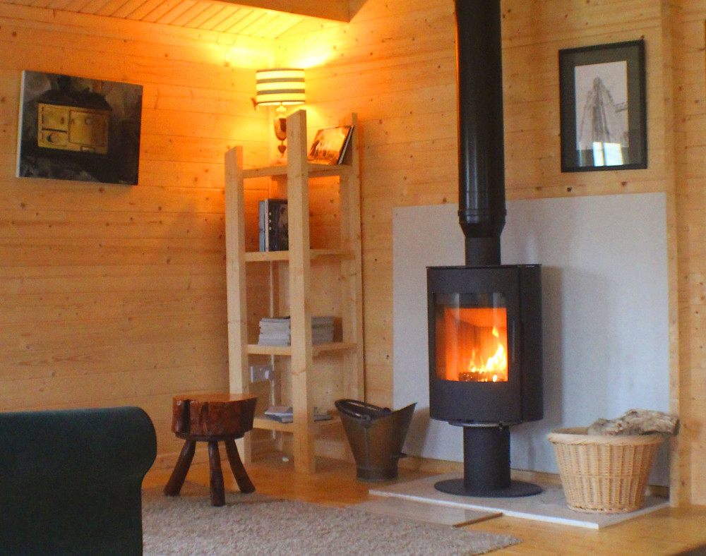 Log cabin with wood stove